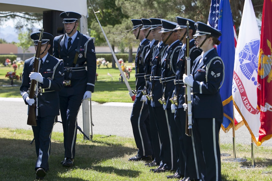 Members of the Nellis Air Force Base Honor Guard exit the Davis Funeral Homes and Memorial Park ceremonial site after the presentation of colors during a Memorial Day ceremony in Las Vegas, May 25. The American, Nevada State, and all Department of Defense military flags waved as flowers graced the graves of deceased veterans. (U.S. Air Force photo by Lorenz Crespo)