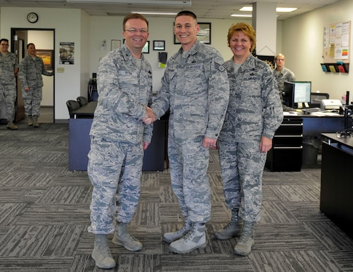 Col. Bill Otter, 19th Airlift Wing vice commander, along with Chief Master Sgt. Rhonda Buening, 19th Airlift Wing command chief, congratulate Staff Sgt. Gary Richard III, a 19th Comptroller Squadron noncommissioned officer in charge budget analyst, for his selection as Combat Airlifter of the Week May 26, 2015, at Little Rock Air Force Base, Ark. Initiated peer to peer training of three Wings in Air Combat Command, Air Mobility Command, and Air Force Global Strike Command on implementation of new Defense Enterprise Accounting Management System which allowed for the transition of over $425 million. (U.S. Air Force photo by Senior Airman Stephanie Serrano)