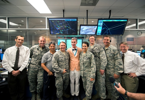 Brig. Gen. Nina Armagno, 45th Space Wing commander, and launch team, pose with Bill Nye, Planetary Society CEO, in the Morrell Operations Center, May 21, 2015, at Cape Canaveral Air Force Station, Fla. Team Patrick-Cape hosted Bill Nye the Science Guy and the Planetary Society team for a tour of CCAFS and met with several Airmen. (Courtesy photo/Navid Baraty/ Planetary Society) (For limited release)
