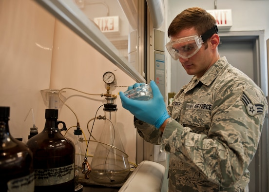 Senior Airman Vincent Costante, 99th Logistics Readiness Squadron fuels laboratory technician, conducts a fuel test at the fuels compound on Nellis Air Force Base, Nev., May 20, 2015. Costante, who plans on competing in his first bodybuilding competition July 4, has been a fuels laboratory technician at Nellis AFB for over five years. (U.S. Air Force photo by Airman 1st Class Jake Carter)