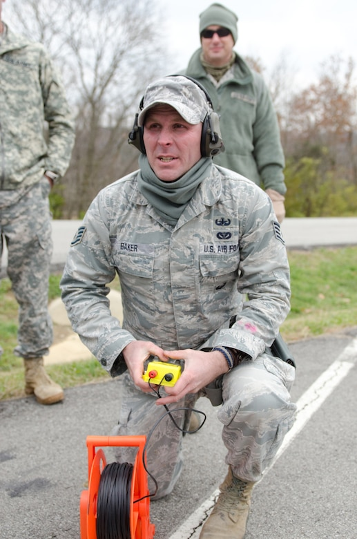 Staff Sgt. Timothy Baker, an Explosive Ordinance Disposal technician for the Kentucky Air National Guard's 123rd Civil Engineer Squadron,  prepares to detonate C4 inside the unit's new Bomb Containment Vessel at a Fern Creek Fire Department training site in Louisville, Ky., Nov. 11, 2014. The steel vessel, which is mounted to a trailer, allows EOD personnel to detonate explosives on-site with no repercussions to nearby people or structures. (U.S. Air National Guard photo by Master Sgt. Phil Speck)