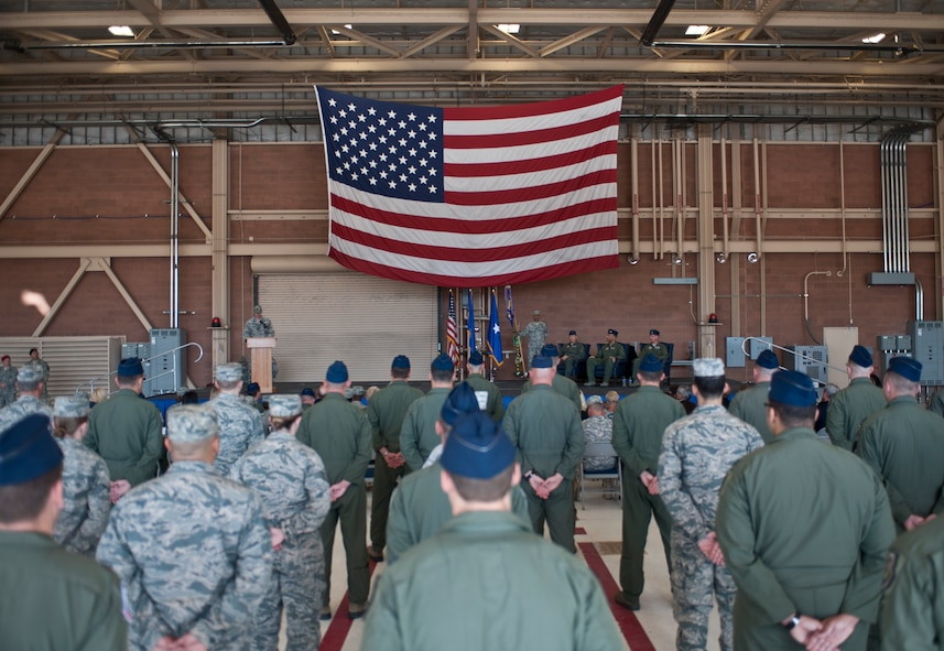 Airmen stand in formation during the opening remarks of the U.S. Air Force Weapons School's change of command ceremony at Nellis Air Force Base, Nev., May 26, 2015. During the ceremony, command of the USAFWS passed from Col. Adrian Spain to Col. Michael Drowley. (U.S. Air Force photo by Staff Sgt. Siuta B. Ika)