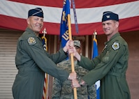 Col. Michael Drowley (right), U.S. Air Force Weapons School commandant, accepts the USAFWS guidon from Brig. Gen. Christopher Short, 57th Wing commander, during the USAFWS's change of command ceremony at Nellis Air Force Base, Nev., May 26, 2015. The passing of the guidon signals the official start of the new commander's tenure in charge. (U.S. Air Force photo by Staff Sgt. Siuta B. Ika)