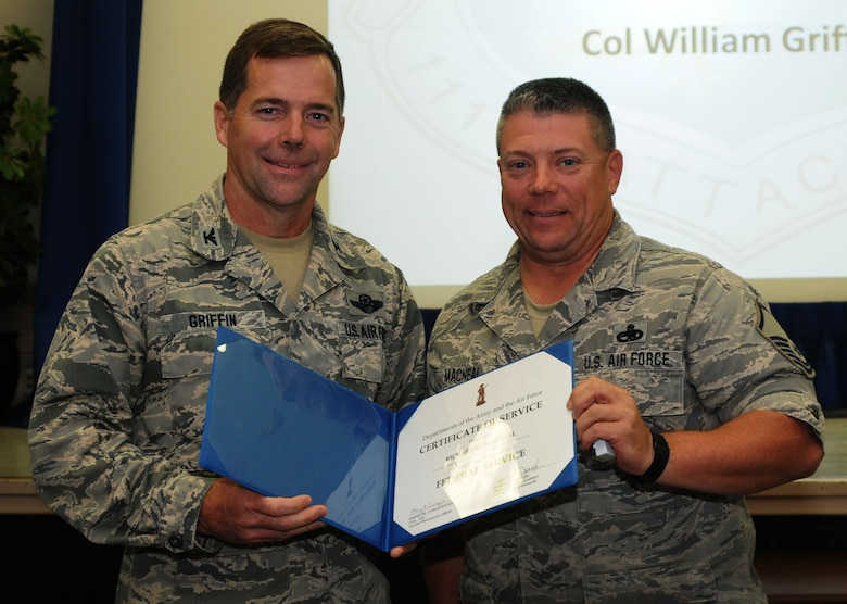 Vice Commander of the 111th Attack Wing Col. William R. Griffin presents Master Sgt. Richard MacNeal, 201st REDHORSE Squadron, Detachment 1, with the Department of the Army and Air Force Certificate of Service for 30 years of federal service on May 21, 2015, in the wing headquarters building, Horsham Air Guard Station, Pennsylvania. The acronym REDHORSE stands for Rapid Engineer Deployable Heavy Operational Repair Squadron Engineer squadrons; and they function as the Air Force's heavy-construction units. (U.S. Air National Guard photo by Tech. Sgt. Andria Allmond/Released)