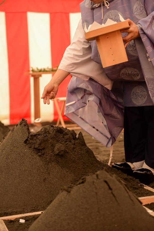 A Shinto priest performs the ground breaking ceremony for the new Yokota High School at Yokota Air Base, Japan, May 19, 2015. The new high school project is intended to include the demolition of existing buildings and support facilities, and the construction of a multi-purpose playing field, parking lots, sidewalks and a loop road.