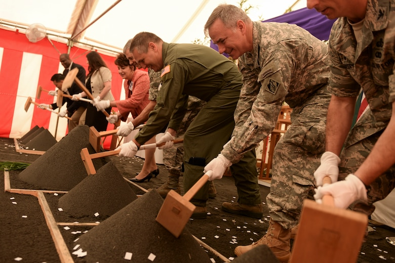 Participants perform the ceremonial ground breaking ceremony for the new Yokota High School at Yokota Air Base, Japan, May 19, 2015. The new school is intended to accommodate 325 students and span 93,120 square feet.