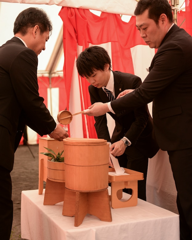 A participant at the new Yokota High School ground breaking ceremony washes his hands before entering the tent where the ceremony was held at Yokota Air Base, Japan, May 19, 2015. Everyone who entered the tent was required to wash first their left, then their right hand in observance of Shinto traditions.