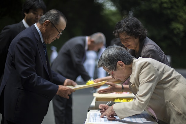Representatives from a variety of groups or organizations check in at the Japan Good Deeds Association's 65th Spring Commendation Ceremony at the Meiji Jingu Gathering Hall in Tokyo, Japan, May 23, 2015. The Good Deeds Association is an organization that recognizes people or groups for they're good conduct in support of the Japanese community. The association recognized service members with Headquarters and Headquarters Squadron and Marine Aerial Transport Refueler Squadron 152 aboard Marine Corps Air Station Iwakuni, Japan, for their assistance with the Iwakuni City Volunteer Council in August 2014, after a mudslide caused by Typhoon Halong.