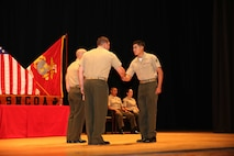 Cpl. Sergio J. Parada, right, tank repair technician, Tank Platoon, Company B, Ground Combat Element Integrated Task Force, is congratulated by Master Sgt. James Slife III, guest speaker, during the Corporal's Course graduation at the Marine Corps Base Camp Lejeune Theater, May 28. From October 2014 to July 2015, the GCEITF conducted individual and collective level skills training in designated ground combat arms occupational specialties in order to facilitate the standards-based assessment of the physical performance of Marines in a simulated operating environment performing specific ground combat arms tasks. (U.S. Marine Corps photo by Cpl. Paul S. Martinez/Released)