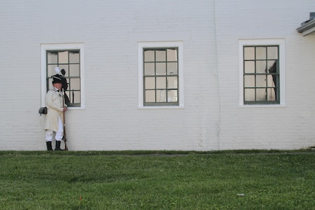 FORT NORFOLK, Va. -- A War of 1812 reenactor rests agains the Officers Quarters/Shell House here June 9, 2012. The reenactors were part of OpSail 2012, which marked the bicentennial of the War of 1812 and brought international tall ships and naval vessels to Hampton Roads and other port cities.  (U.S. Army photo/Kerry Solan)