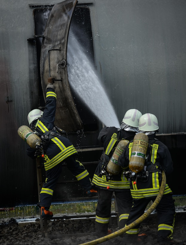 Lithuanian air force firefighters prepare for a simulated aircraft fire during a NATO Firefighter Fundamentals course May 20, 2015, at Ramstein Air Base, Germany. Instructors from the 435th Construction and Training Squadron led a team of more than 20 firefighters through scenarios that included confined-space rescue, structural collapse, aircraft and structural firefighting, crash recovery and incident command system training. (U.S. Air Force photo/Senior Airman Nicole Sikorski)
