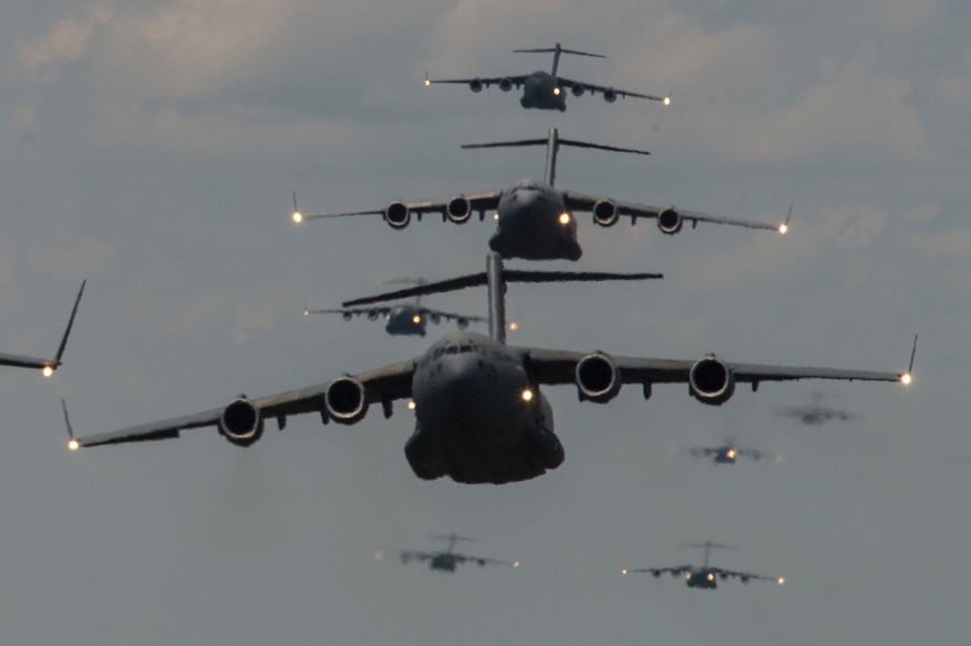 437th Airlift Wing at Joint Base Charleston, S.C., conduct a multi-ship C-17 Globemaster III formation during Crescent Reach 15 on May 21, 2015