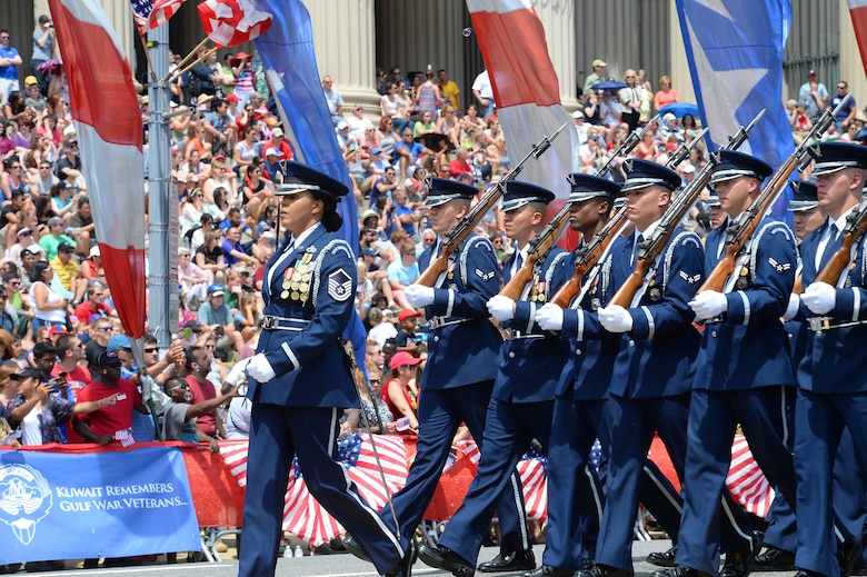 The U.S. Air Force Honor Guard marches during the National Memorial Day Parade in Washington, D.C., May 25, 2015.  The National Memorial Day Parade was first launched in 2005 by the American Veterans Center. (U.S. Air Force photo/Scott M. Ash)