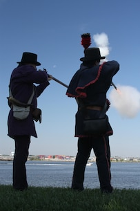 FORT NORFOLK, Va. -- War of 1812 reenactors fire their weapons from the ramparts here June 9, 2012. The reenactors were part of OpSail 2012, which marked the bicentennial of the War of 1812 and brought international tall ships and naval vessels to Hampton Roads and other port cities.  (U.S. Army photo/Kerry Solan)
