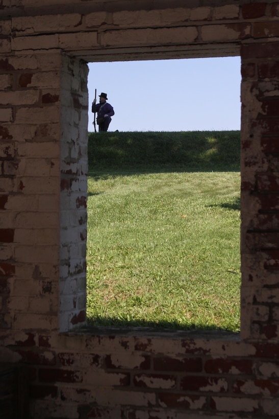 FORT NORFOLK, Va. -- A War of 1812 reenactor is visible through the fort's stable window June 9, 2012. The reenactors were part of OpSail 2012, which marked the bicentennial of the War of 1812 and brought international tall ships and naval vessels to Hampton Roads and other port cities.  (U.S. Army photo/Kerry Solan)
