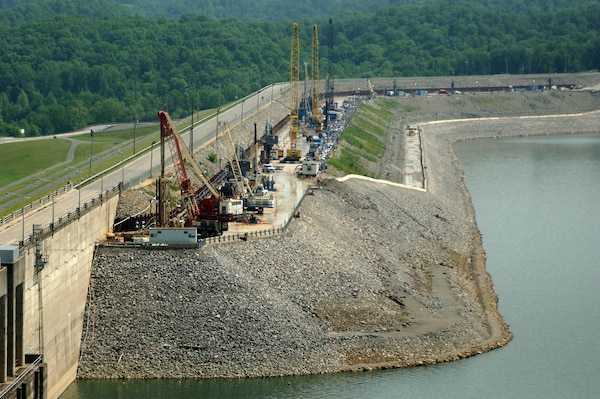 A concrete barrier wall is being constructed in the Wolf Creek Dam embankment May 2, 2012.