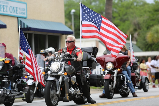 Motorcyclists display American Flags as they ride in the annual Memorial Day Parade on Boundary St. in Beaufort, May 25. The bikers, along with high school bands, war veterans, and local community groups paraded through downtown Beaufort to honor the men and women who died in service of their country.