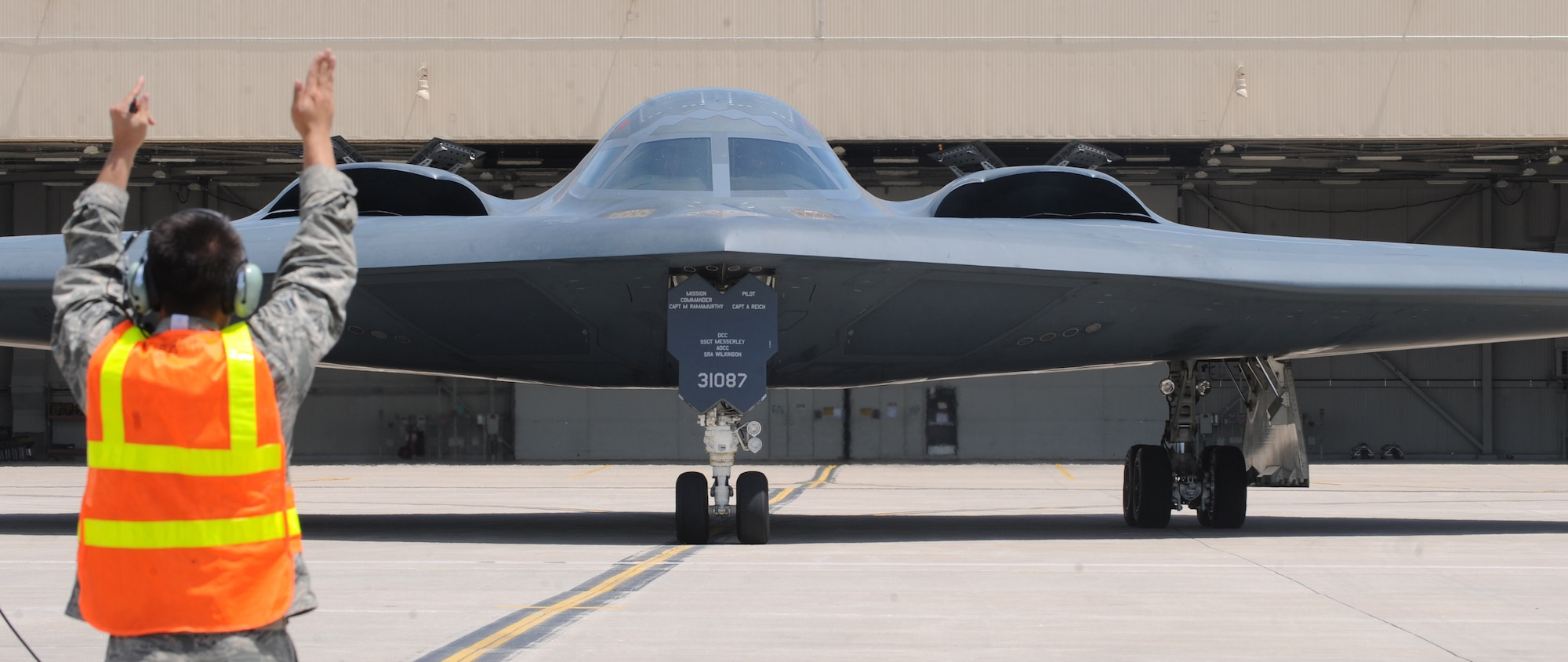 A 509th Aircraft Maintenance Squadron crew chief marshals a B-2A Spirit bomber piloted by Lt. Gen. Philippe Steininger, the commander of the French air force's Strategic Air Forces Command, during an orientation flight at Whiteman Air Force Base, Mo., May 27, 2015. This was Steininger's first visit to an Air Force Global Strike Command base since assuming command. (U.S. Air Force photo/Staff Sgt. Alexandra M. Longfellow)