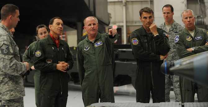 Air Force Lt. Gen. Stephen Wilson (center), the Air Force Global Strike Command commander, explains the wing's mission to Lt. Gen. Philippe Steininger, the commander of the French air force's Strategic Air Forces Command at Whiteman Air Force Base, Mo., May 26, 2015. Since its standup in 2009, AFGSC has worked to build and maintain a strong relationship with its allies in the French air forces. (U.S. Air Force photo/Staff Sgt. Alexandra M. Longfellow)