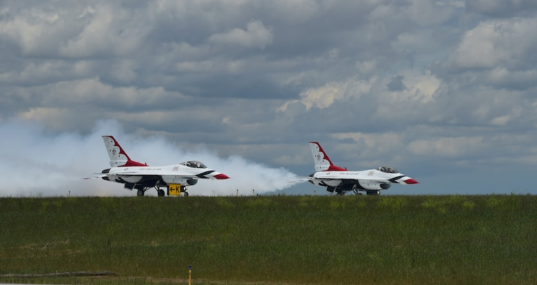 Two Thunderbirds await take-off on the tarmac May 29, 2015 on Buckley Air Force Base, Colo. The Thunderbirds are staging out of Buckley AFB for the up-coming Rocky Mountain Air Show. (U.S. Air Force photo by Airman 1st Class Luke W. Nowakowski/Released)