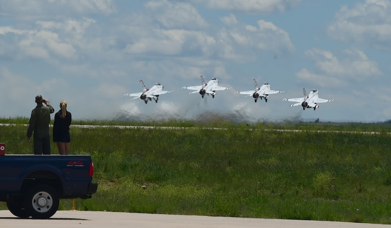 Four Thunderbirds depart for a training mission May 29, 2015 from Buckley Air Force Base, Colo. The Thunderbirds are staging out of Buckley AFB for the up-coming Rocky Mountain Air Show. (U.S. Air Force photo by Airman 1st Class Luke W. Nowakowski/Released)