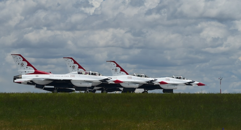 Thunderbirds race down the runway before ascending in the air May 29, 2015 on Buckley Air Force Base, Colo. The Thunderbirds are staging out of Buckley AFB for the up-coming Rocky Mountain Air Show. (U.S. Air Force photo by Airman 1st Class Luke W. Nowakowski/Released)
