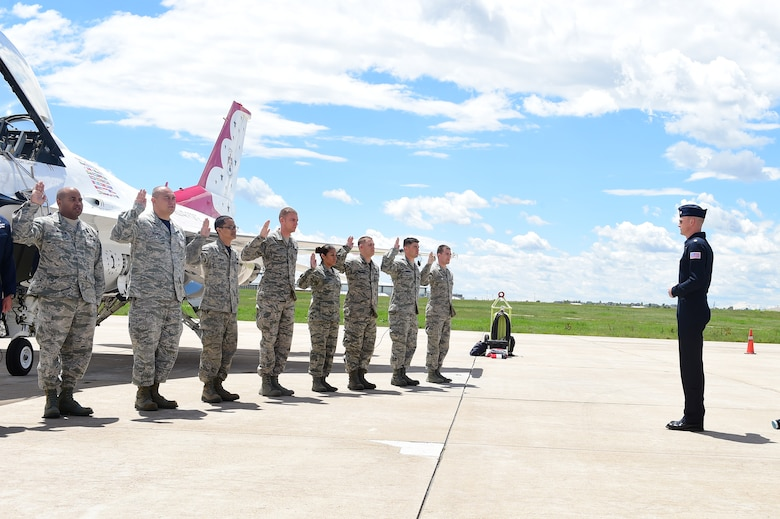 Lt. Col. Christopher Hammond, Thunderbird 1, re-enlists Team Buckley Airmen May 29, 2015 on Buckley Air Force Base, Colo. The Thunderbirds are staging out of Buckley AFB for the up-coming Rocky Mountain Air Show. (U.S. Air Force photo by Airman 1st Class Luke W. Nowakowski/Released)