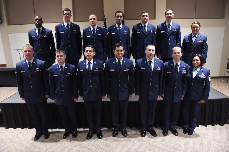 Team Buckley members were promoted to their next ranks May 29, 2015, at the Leadership Development Center on Buckley Air Force Base, Colo. A promotion ceremony is a time-honored tradition in the Air Force, allowing co-workers, family and friends to support and congratulate Airmen on their promotion. (U.S. Air Force photo by Airman 1st Class Samantha Meadors/Released)
