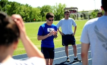 U.S. Air Force Staff Sgt. Brendan Brustad, 509th Medical Support Squadron NCO in charge of medical contracting, shares a few words after completing his 161-mile run at Whiteman Air Force Base, Mo., May 21, 2015. Brustad's co-workers from the 509th MDSS joined him for the final stretch of his run. (U.S. Air Force photo by Senior Airman Joel Pfiester/Released)