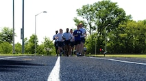 U.S. Air Force Staff Sgt. Brendan Brustad along with his co-workers from the 509th Medical Support Squadron run the final stretch of Brustad's 161-mile run at Whiteman Air Force Base, Mo., May 21, 2015. Brustad ran approximately 26 miles a day for six days to honor the victims of the 2011 Joplin, Mo. tornado. (U.S. Air Force photo by Senior Airman Joel Pfiester/Released)