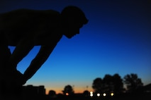 U.S. Air Force Staff Sgt. Brendan Brustad, 509th Medical Support Squadron NCO in charge of medical contracting, catches his breath during a 161 mile run May 19, 2015, at Whiteman Air Force Base, Mo. Brustad ran approximately 26 miles a day for six days to honor the victims of the 2011 Joplin tornado. (U.S. Air Force photo by Senior Airman Joel Pfiester/Released)