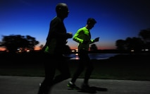 U.S. Air Force Staff Sgt. Brendan Brustad and 1st Lt. James Laughridge, both from the 509th Medical Support Squadron, run during the early hours of the day at Whiteman Air Force Base, Mo., May 19, 2015. Brustad ran 161 miles to honor the 161 victims of an EF5 tornado that happened May 22, 2011, in Joplin, Mo. (U.S. Air Force photo by Senior Airman Joel Pfiester/Released)