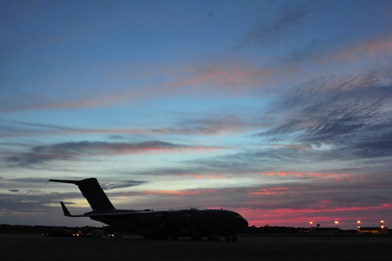 A C-17 Globemaster from Charleston Air Force Base, S.C. sits on the flightline, May 27, 2015, from Hurlburt Field, Fla.  The C-17 was loaded with 823rd RED HORSE members and medical vehicles and took off in support of NEW HORIZONS 2015, an annual event conducted to train military civil engineers and medical professionals to deploy and conduct joint operations. (U.S. Air Force photo by Airman 1st Class Ryan Conroy/Released)