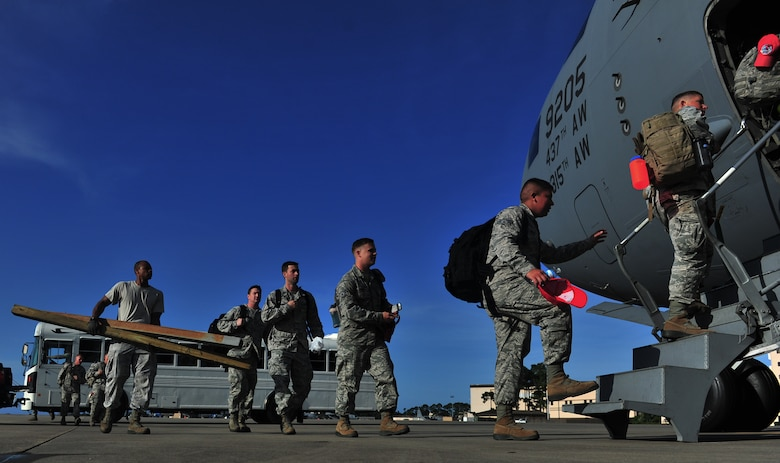 Members of the 823rd RED HORSE board a C-17 Globemaster, May 27, 2015, at Hurlburt Field, Fla. Twelfth Air Force , in conjunction with the U.S. Embassy and government of Honduras, is currently conducting NEW HORIZONS 2015, an annual event conducted to train military civil engineers and medical professionals to deploy and conduct joint operations.  (U.S. Air Force photo by Airman 1st Class Ryan Conroy/Released)