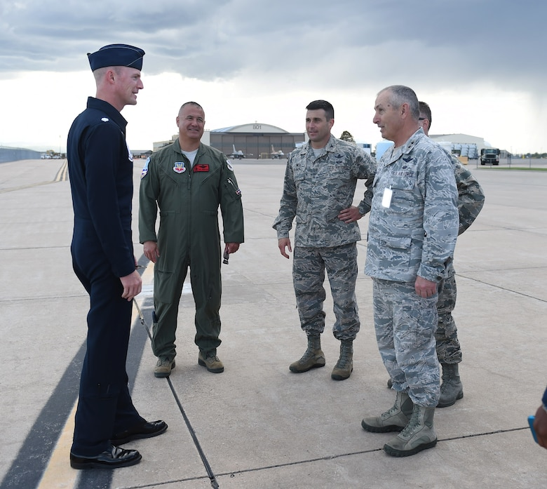 A Thunderbirds demonstration pilot speaks with Team Buckley leadership May 28, 2015, on the flight line on Buckley Air Force Base, Colo. The Thunderbirds team is staging out of Buckley AFB and will be performing in the 2015 Rocky Mountain Air Show May 30-31. (U.S. Air Force photo by Airman 1st Class Samantha Meadors/Released)