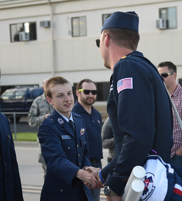 A Thunderbird demonstration pilot shakes the hand of a Civil Air Patrol cadet May 28, 2015, on the flight line on Buckley Air Force Base, Colo. The Thunderbirds team is staging out of Buckley AFB and will be performing in the 2015 Rocky Mountain Air Show May 30-31. (U.S. Air Force photo by Airman 1st Class Samantha Meadors/Released)