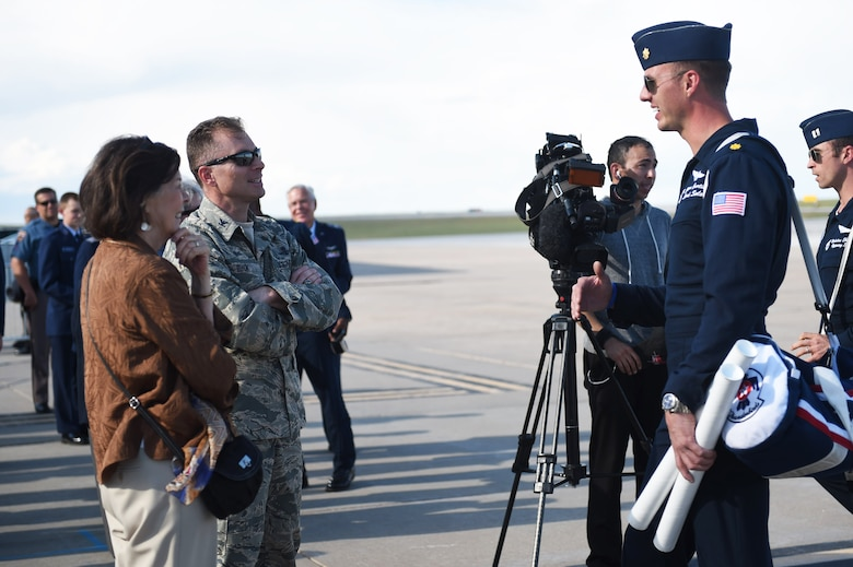 Maj. Jason Curtis, Thunderbird 5, speaks with Col. Darren Buck, 460th Vice Wing commander, May 28, 2015, on the flight line on Buckley Air Force Base, Colo. The Thunderbirds team is staging out of Buckley AFB and will be performing in the 2015 Rocky Mountain Air Show May 30-31. (U.S. Air Force photo by Airman 1st Class Samantha Meadors/Released)