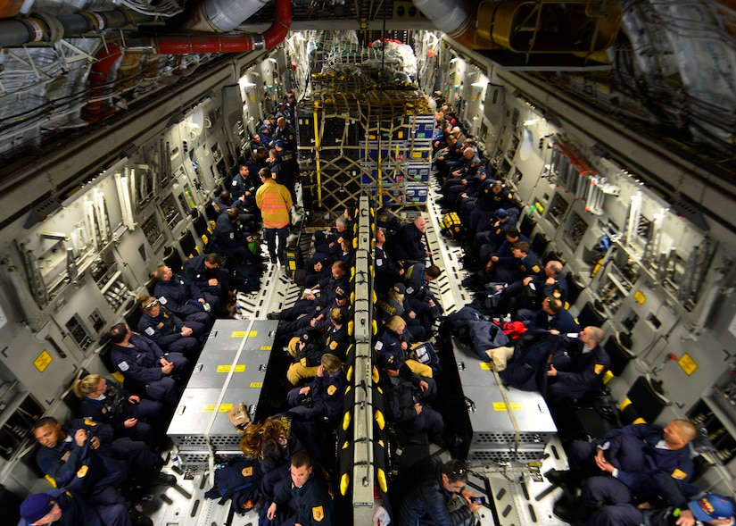 Sixty-nine members of the Fairfax County Urban Search and Rescue Team await takeoff on a U.S. Air Force C-17 Globemaster III at Dover Air Force Base, Del., April 26, 2015. The specially trained team and approximately 70,000 pounds of their supplies were deployed to Nepal to assist with rescue operations after the country was struck by a 7.8-magnitude earthquake. (U.S. Air Force photo by Airman 1st Class William Johnson)