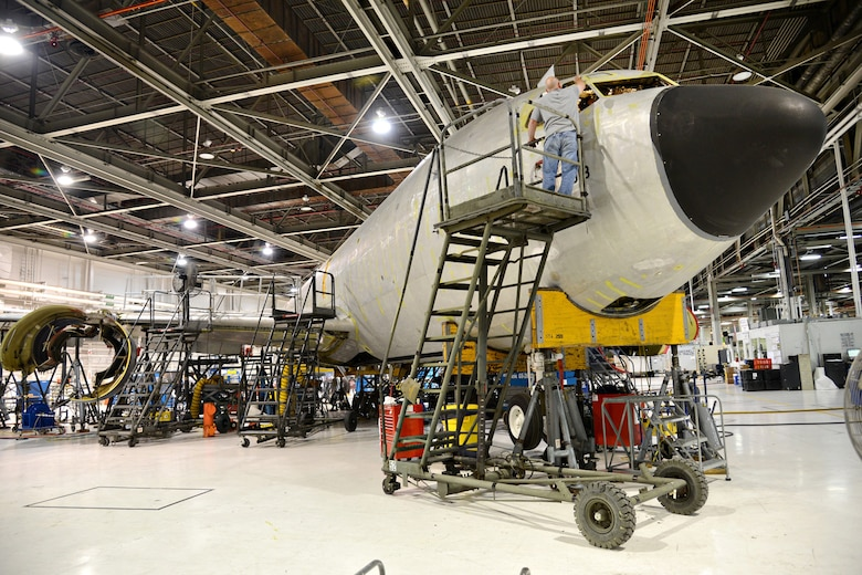 Aircraft Mechanic Steven Harris, 564th Aircraft Maintenance Squadron, preps the #1 and #4 window areas for installation on a KC-135 Stratotanker. The workers in programmed depot maintenance line recently broke their own record by completing a PDM in 86 days. (Air Force photo by Kelly White/Released)