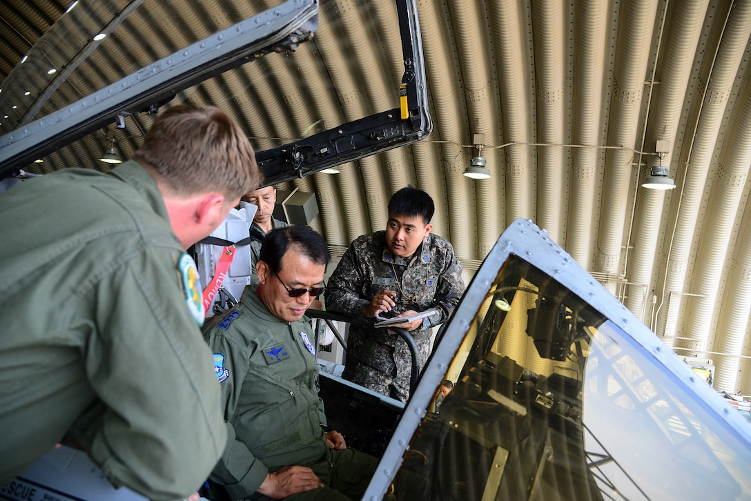 Republic of Korea air force Lt. Gen. Jeong Sig Kim, ROKAF Operations Command commander, sits in an A-10 Thunderbolt II during an immersion tour of the 51st FW, May 28, 2015, at Osan Air Base, Republic of Korea. Lt. Gen. Kim learned about what the 51st FW does for Osan as well as its capabilities in the ROK. (U.S. Air Force photo by Senior Airman Matthew Lancaster)