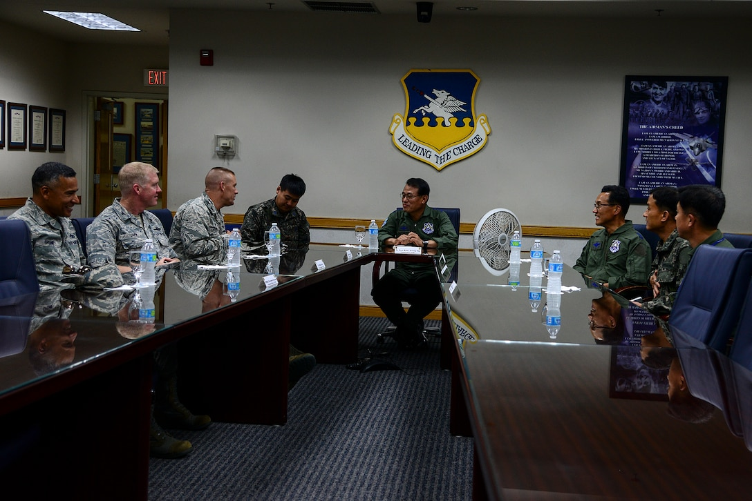 Republic of Korea air force Lt. Gen. Jeong Sig Kim, ROKAF Operations Command commander, has an office call with 51st Fighter Wing leadership during an immersion tour of the 51st FW, May 28, 2015, at Osan Air Base, Republic of Korea. Lt. Gen. Kim learned about what the 51st FW does for Osan as well as its capabilities in the ROK. (U.S. Air Force photo by Senior Airman Matthew Lancaster)