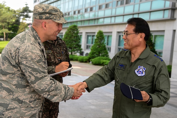 Col. Brook Leonard, 51st Fighter Wing commander, greets Republic of Korea air force Lt. Gen. Jeong Sig Kim, ROKAF Operations Command commander, during an immersion tour of the 51st FW, May 28, 2015, at Osan Air Base, ROK. Lt. Gen. Kim learned about what the 51st FW does for Osan as well as its capabilities in the ROK. (U.S. Air Force photo by Senior Airman Matthew Lancaster)