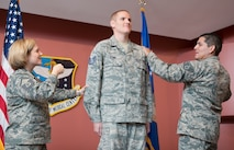 Master Sgt. Tanya Hubbard and Staff Sgt. Roberto Davila, both assigned to the 60th Medical Group, tack staff sergeant stripes onto Spencer Stone, a 60th Medical Operations Squadron medical technician, during a promotion ceremony at Travis Air Force Base, Calif., Oct. 30, 2015. Stone was promoted to the rank of staff sergeant, effective Nov. 1, by order of Air Force Chief of Staff Gen. Mark A. Welsh III. Stone was promoted to staff sergeant for the leadership and courage he showed in August when he and two friends thwarted a potential terrorist attack on a train traveling to Paris. (U.S. Air Force photo/Ken Wright)