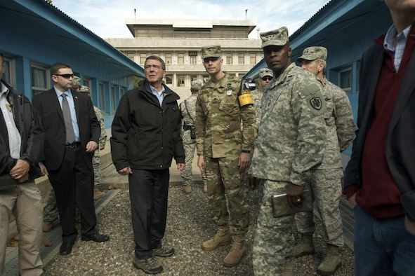 U.S. Defense Secretary Ash Carter speaks with U.S. Army Col. James Minnich, Secretary of the United Nations Command Military Armistice Commission, as he visits the Demilitarized Zone in the Republic of Korea, Nov. 1, 2015. Carter is visiting the Asia-Pacific region, where he will meet with leaders from more than a dozen nations to help advance the next phase of the U.S. military's rebalance in the region by modernizing longtime alliances and building new partnerships. Photo by Air Force Senior Master Sgt. Adrian Cadiz
