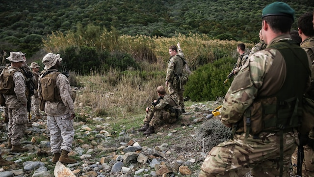 Royal Marines with 45 Commando and U.S. Marines with Special-Purpose Marine Air-Ground Task Force Crisis Response-Africa discuss patrolling tactics during Trident Juncture 15, Oct. 21, 2015. Trident Juncture is one of many exercises ensuring that NATO is ready to deal with any emerging crisis from any direction, and that the Alliance is able to work effectively with partner nations.