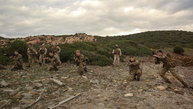 Royal Marines with 45 Commando demonstrate patrol movements during Trident Juncture 15, Oct. 21, 2015. Trident Juncture is one of many exercises ensuring that NATO is ready to deal with any emerging crisis from any direction, and that the Alliance is able to work effectively with partner nations.