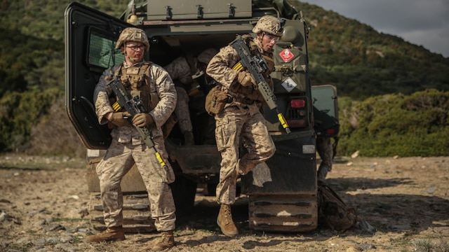 U.S. Marines with Special-Purpose Marine Air-Ground Task Force Crisis Response-Africa exit a British Viking during Trident Juncture 15, Oct. 22, 2015. Trident Juncture is one of many exercises ensuring that NATO is ready to deal with any emerging crisis from any direction, and that the Alliance is able to work effectively with partner nations.