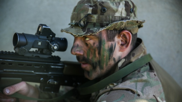 A Royal Marine with 45 Commando provides security during Trident Juncture 15, Oct. 23, 2015. Trident Juncture is one of many exercises ensuring that NATO is ready to deal with any emerging crisis from any direction, and that the Alliance is able to work effectively with partner nations.