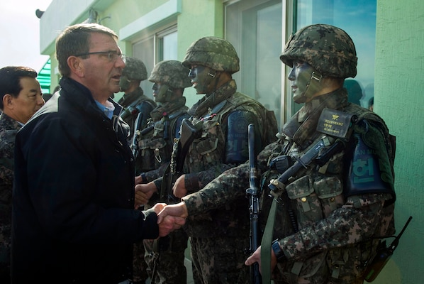 U.S. Defense Secretary Ash Carter shakes hands with Republic of Korea soldiers during a visit to the Demilitarized Zone, in the Republic of Korea, Nov.1, 2015. Carter is visiting the Asia-Pacific region, where he will meet with leaders from more than a dozen nations to help advance the next phase of the U.S. military's rebalance in the region by modernizing longtime alliances and building new partnerships. Photo by Air Force Senior Master Sgt. Adrian Cadiz