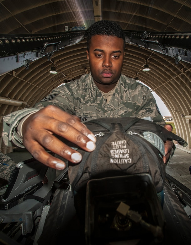 Staff Sgt. Angelo Lowe, 8th Maintenance Squadron egress craftsman, performs an inspection on the landing gear of an F-16 Fighting falcon at Kunsan Air Base, Republic of Korea, Oct. 29, 2015. These recurring inspections are used to visually identify any issues or concerns that could interfere with a pilot's ejection. (U.S. Air Force photo by Staff Sgt. Nick Wilson/Released)
